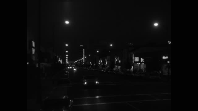 wide shot of traffic driving on busy street at night in city, beverly hills, california, usa - 1965 stock videos & royalty-free footage