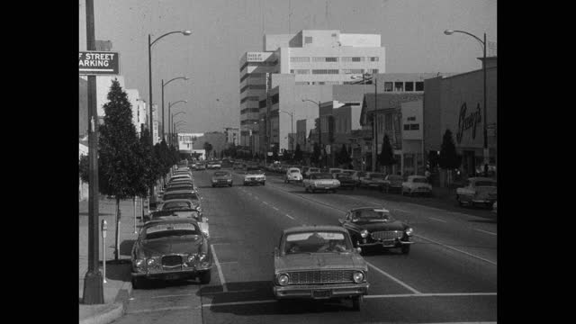 wide shot of traffic driving on busy street in city, beverly hills, california, usa - beverly hills california stock videos & royalty-free footage