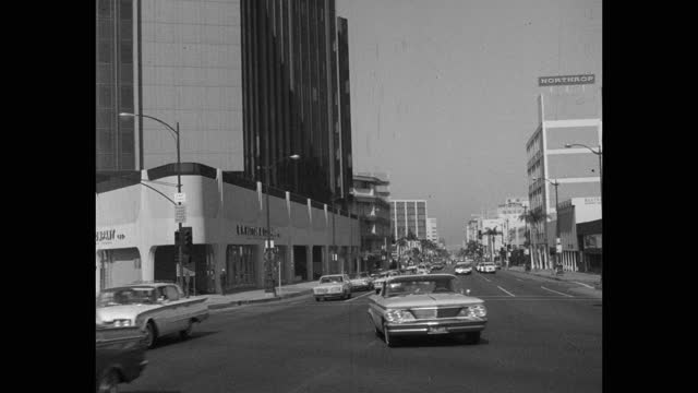 wide shot of traffic driving on busy street in city, beverly hills, california, usa - 1965 stock videos & royalty-free footage