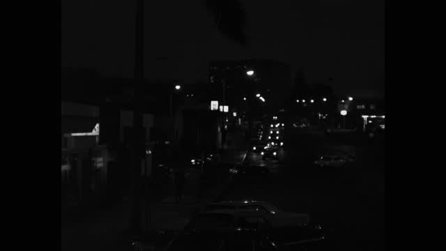 wide shot of traffic driving on street at night in small town, la jolla, california, usa - 1967 stock videos & royalty-free footage