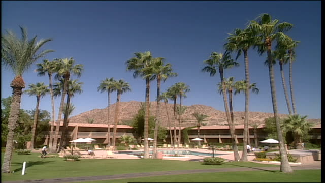 wide shot of trees and exterior of resort in phoenix arizona - natural land state stock videos & royalty-free footage