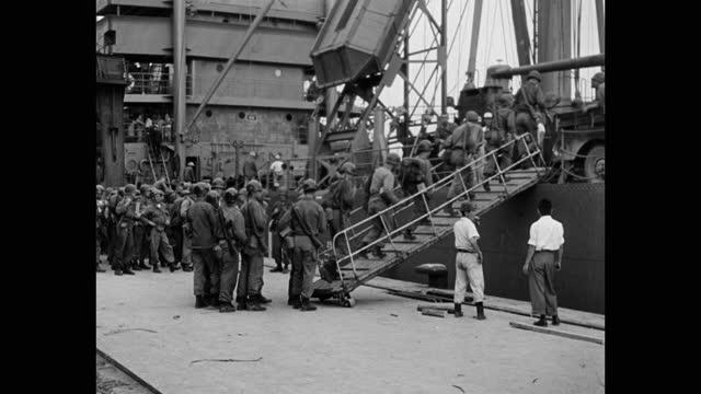 wide shot of troops boarding ship moored at harbor - korean war - military uniform stock videos & royalty-free footage
