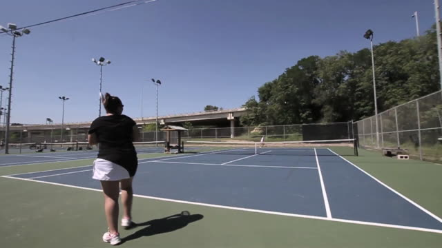 wide shot of two women playing tennis - wide shot stock videos & royalty-free footage
