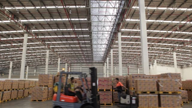 wide shot of Unilever warehouse / employees moving boxes of products around Unilever Warehouse on October 16 2012 in Lat Krabang Thailand