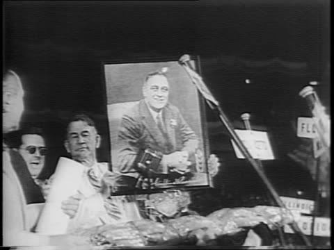 wide shot of us capitol building from a moving vehicle / montage of senator alben barkley barkley holding up a poster of fdr / exterior of us... - alben w. barkley stock videos and b-roll footage