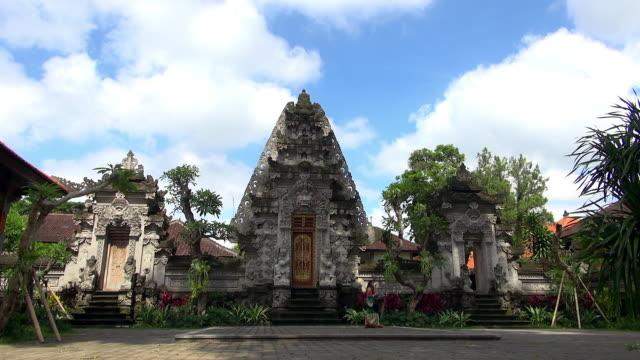 wide shot of woman walking across temple - famous place点の映像素材/bロール
