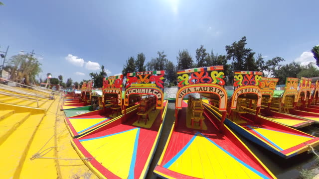 wide shot of xochimilco trajineras or tourboats - aztec stock videos & royalty-free footage