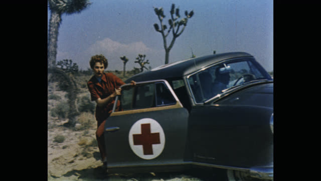 wide shot of young women getting out of car in desert - science fiction film stock videos & royalty-free footage