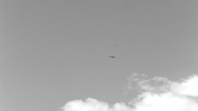 wide shot of zero model fighter planes swoop around each other in world war ii dog fight - 1942 stock videos & royalty-free footage