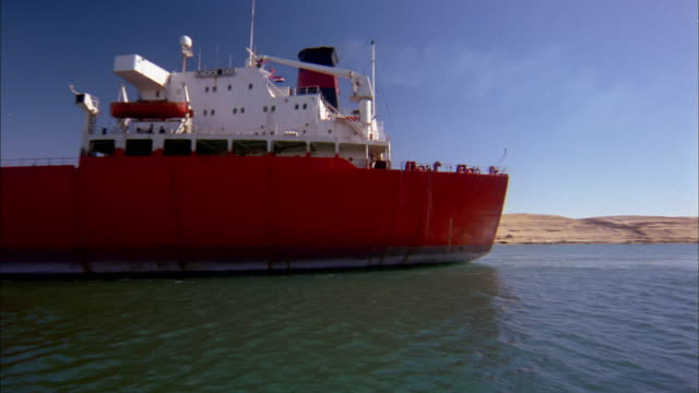 wide shot oil tanker ship on suez canal / egypt - suez canal stock videos & royalty-free footage