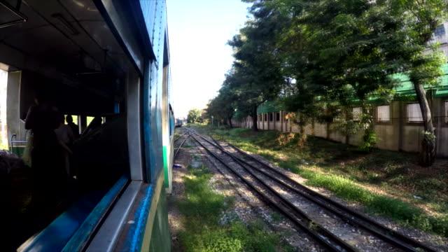 Wide shot Old Circular train of Yangon entering main station Shot on January 2016