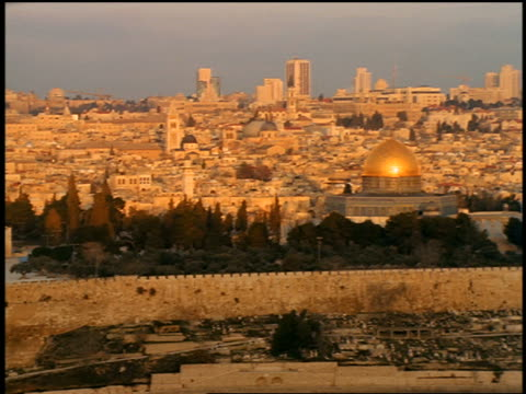 wide shot PAN Old City with Dome of the Rock mosque on Temple Mount in foreground / Jerusalem, Israel
