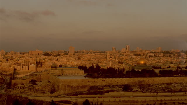 wide shot old city with time lapse sunrise / dome of the rock visible / skyscrapers in background / jerusalem, israel - jerusalem stock videos & royalty-free footage