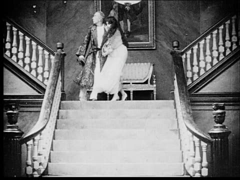 1916 b/w wide shot older man and woman running down stairs and man sword fighting with soldiers on landing - 1916 stock videos & royalty-free footage