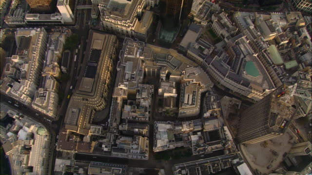 wide shot overhead pan financial district, including sir norma foster building and tower 42 / london - sir norman foster building stock videos & royalty-free footage