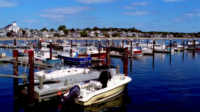 Wide shot pan boats moored in marina/ Provincetown, Massachusetts