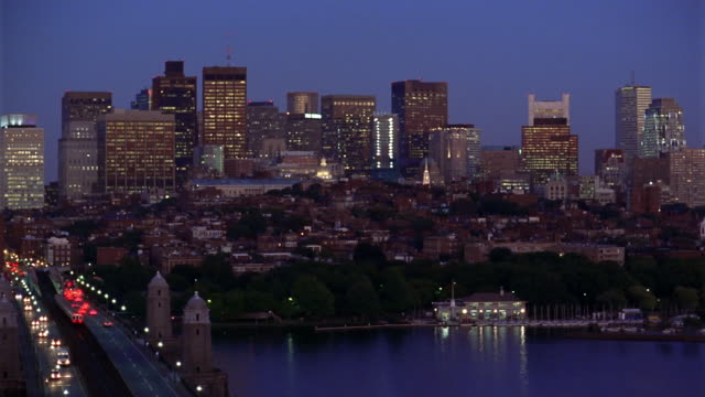 Wide shot pan Boston Skyline with Longfellow Bridge and Charles River in foreground