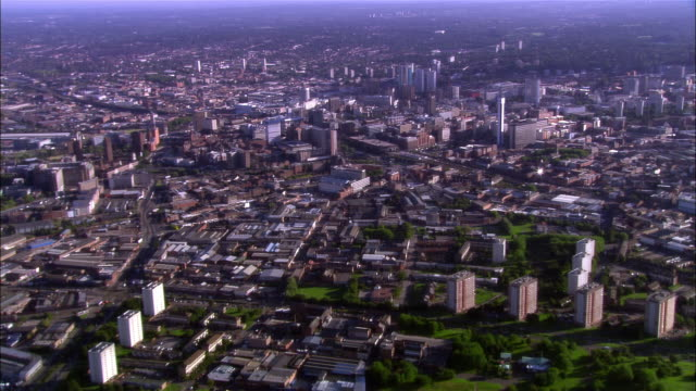 wide shot pan buildings crowding cityscape/ birmingham, england - birmingham england stock videos & royalty-free footage