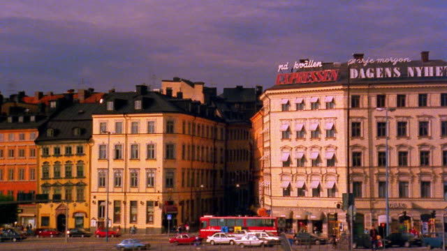 stockvideo's en b-roll-footage met wide shot pan buildings, streets, and square in stockholm / sweden - 1993