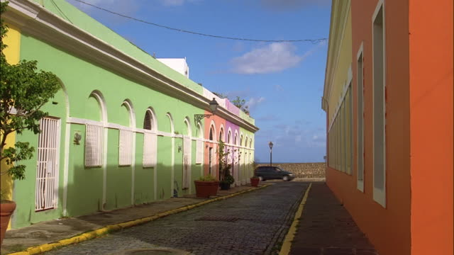 wide shot pan colorful buildings along brick road / old san juan, puerto rico - puerto rico stock videos and b-roll footage