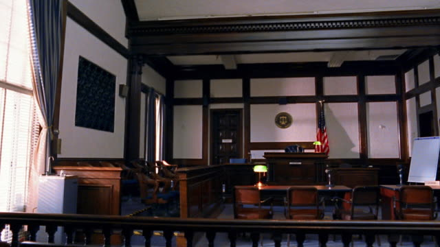 wide shot pan empty courtroom - court room stock videos & royalty-free footage