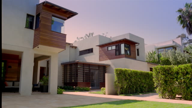 Wide shot pan exterior view of modern house
