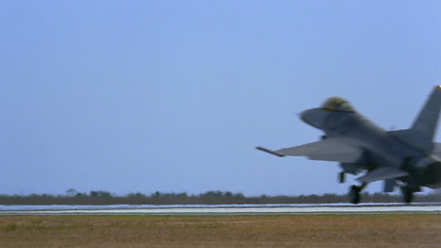 wide shot pan fighter jet landing - us air force stock videos & royalty-free footage