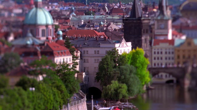wide shot pan from buildings along charles bridge on vltava river / prague, czech republic - vltava river stock videos & royalty-free footage