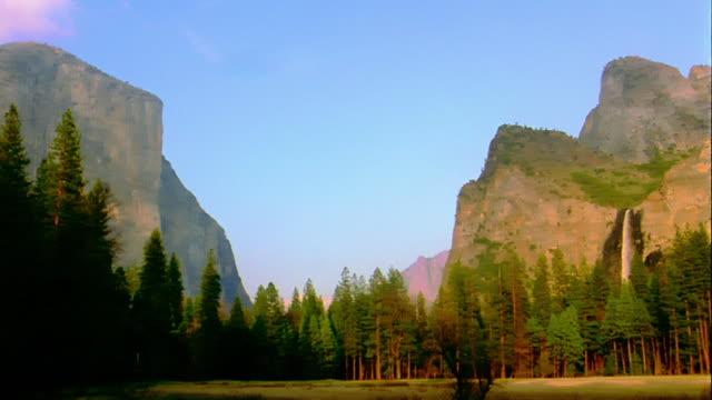 Wide shot pan from El Capitan to Bridalveil Falls / Yosemite National Park, California