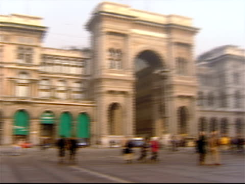 wide shot pan from entrance to galleria vittorio emanuele ii across the piazza del duomo to the duomo di milano / milan, italy - galleria vittorio emanuele ii stock videos and b-roll footage