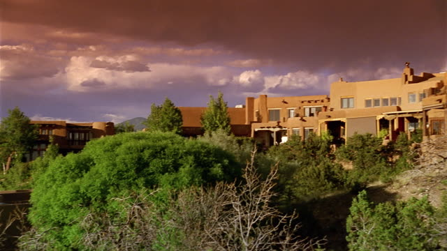 Wide shot pan houses on residential hillside / Santa Fe, New Mexico