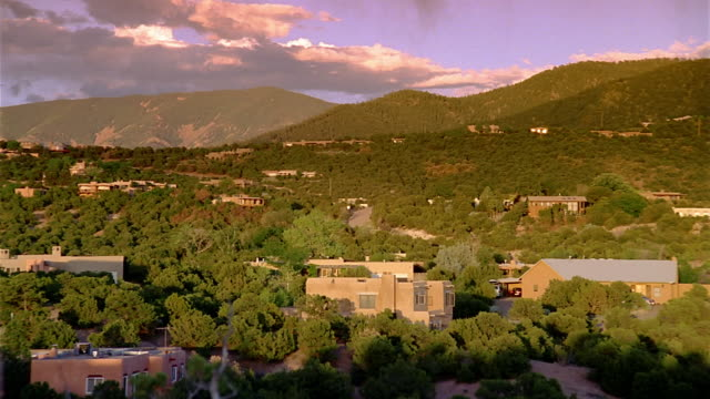 wide shot pan houses on residential hillside / santa fe, new mexico - santa fe new mexico stock videos & royalty-free footage
