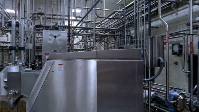 Wide shot pan machinery at a water purification plant / San Antonio, Texas
