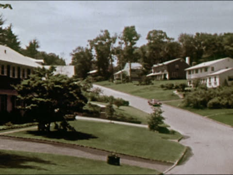 1964 wide shot pan middle class suburban street / long island, new york / audio - long island video stock e b–roll