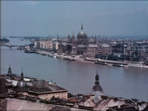 1938 wide shot pan over Danube River and city skyline in Budapest / Hungary