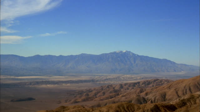 wide shot pan over mountains and desert / california - londonalight stock videos and b-roll footage