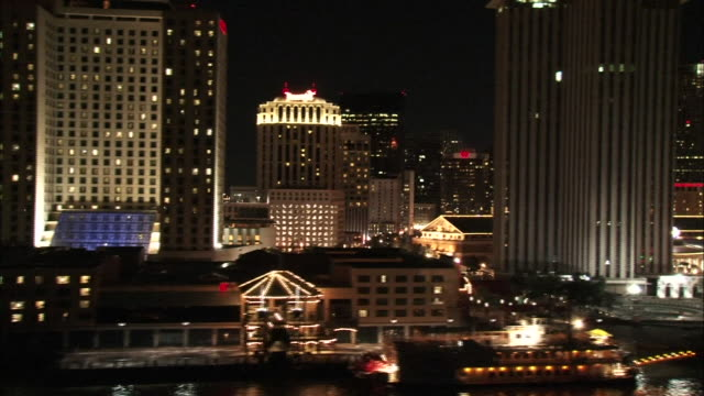 Wide Shot Pan Right Aerial - City scene at night / New Orleans Louisiana