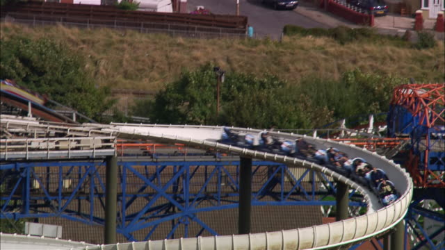 wide shot pan rollercoaster/ blackpool, england - blackpool stock-videos und b-roll-filmmaterial
