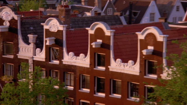 wide shot pan roofs to view of city / amsterdam, holland - cityscape stock videos & royalty-free footage