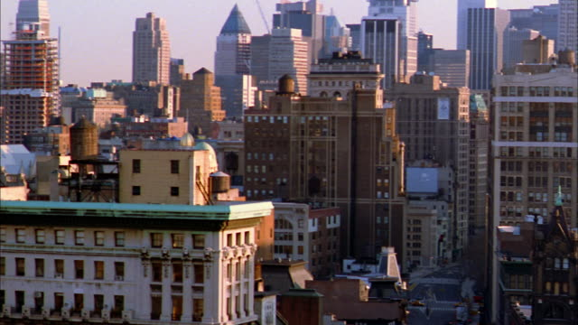 Wide shot pan rooftops of midtown Manhattan / NYC
