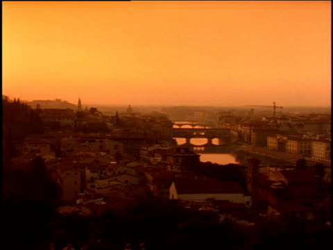 1996 wide shot pan sun setting over florence cityscape with duomo santa maria del fiore/ florence, italy - duomo santa maria del fiore stock videos and b-roll footage