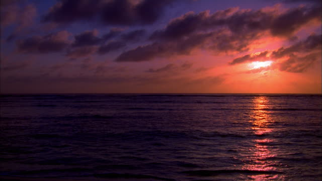 wide shot pan sunset over pacific ocean - pacific ocean stock videos & royalty-free footage