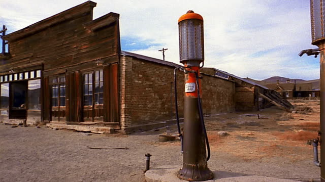 wide shot pan tilt up ghost town at bodie state historic park / california - fuel pump stock videos and b-roll footage
