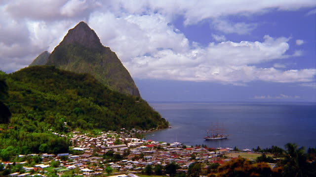 wide shot pan time lapse clouds over harbor / st lucia - st lucia stock videos & royalty-free footage