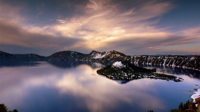 Wide shot pan time lapse clouds rolling over Crater lake / Mount Mazama, Oregon