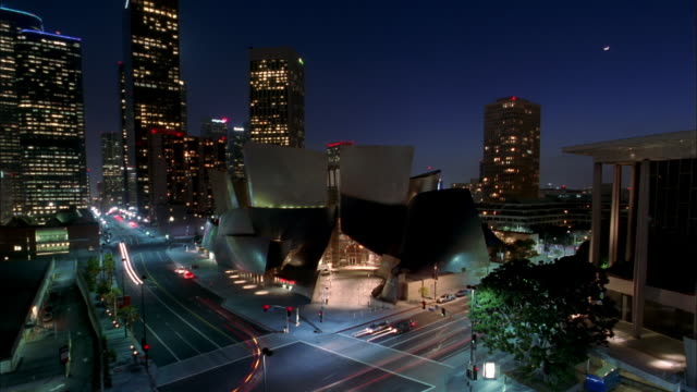 Wide shot pan time lapse traffic outside Walt Disney Concert Hall at night