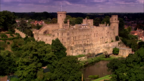wide shot pan tourists sightseeing at warwick castle on bank of avon river/ warwick, warwickshire, england - english culture stock videos & royalty-free footage