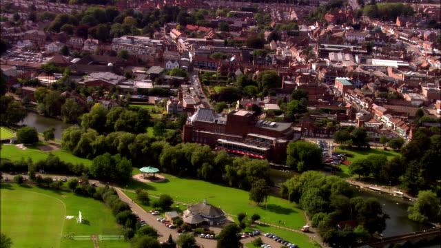 Wide shot pan Town and houses surrounding Royal Memorial Theatre/ Stratford-upon-Avon, Warwickshire, England