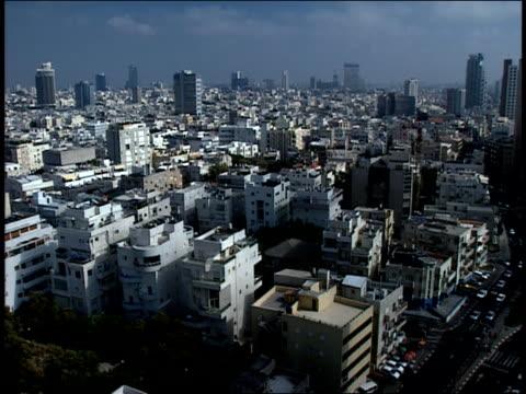 2006 wide shot pan traffic driving on street near crowded city skyline/ jerusalem, israel - jerusalem stock videos and b-roll footage