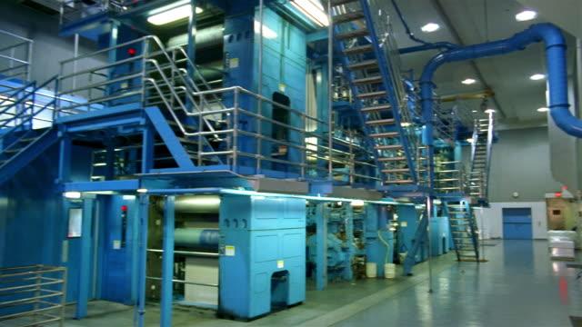 wide shot pan view of santa barbara news press printing press - wide stock videos and b-roll footage
